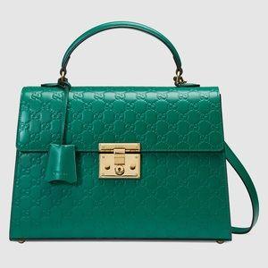 Gucci padlock top handle green. Firm price